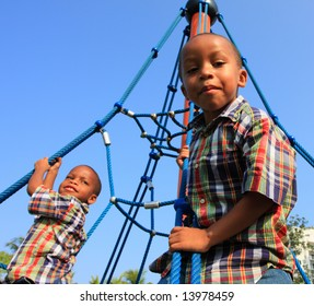 Brothers Climbing Ropes in the Park