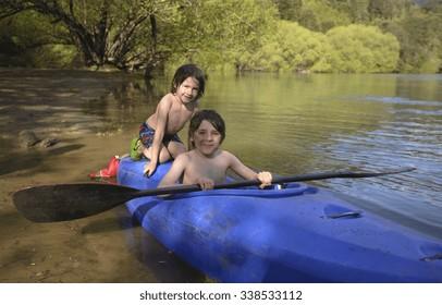 Brothers Having Fun in a Kayak
