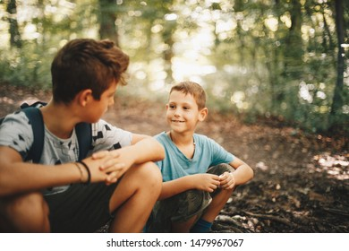 Brothers hikers resting in a forest.