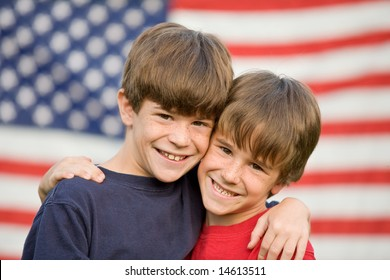 Brothers Hugging in Front of Flag