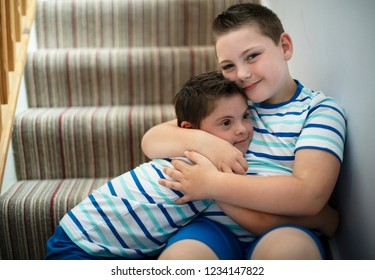 Brothers hugging at the stairs