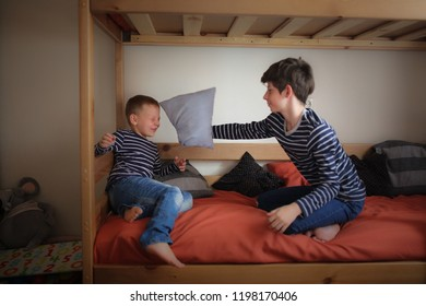 Brothers play on two bunk beds in the nursery, concept relationships and childhood