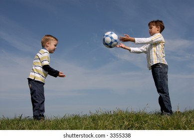 Brothers playing with a ball