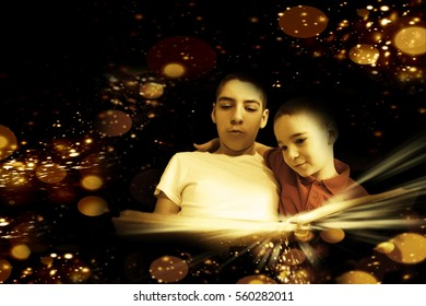 Brothers reading a magic book together