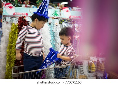 Brothers are shopping in the supermarket for preparing the new year party.
