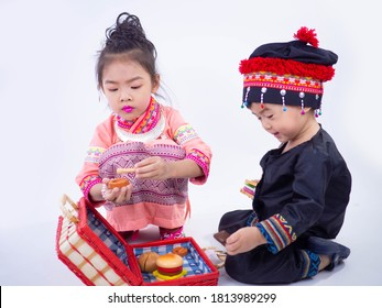 Brothers and sisters in traditional costumes are playing on white back ground