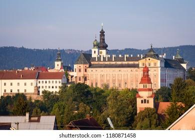 Broumov, Czech Republic. View on famous monastery of Broumov and the broumov walls in the background. Broumov, Hradec Kralove, Czech Republic.