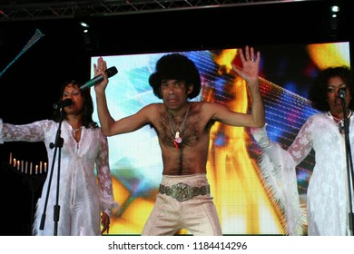 Brovary, Ukraine, 30.12.2006 Concert of the Boney M vocal group. Soloists Liz Mitchell, Maizie Williams and Bobby Farrell are singing on the stage. They are dressed in a white concert costumes