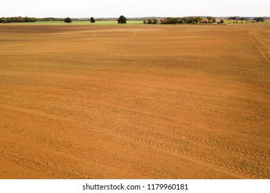 Brown agricultural fields in autumn time.