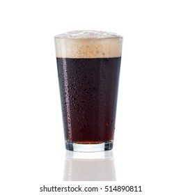 Brown amber beer glass with foam and sweat drops isolated on white with glass reflection