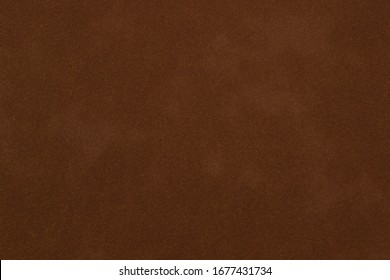 brown artificial leather with waves and folds on PVC base