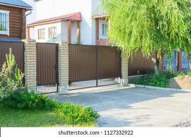 Brown automatic gates in the cottage