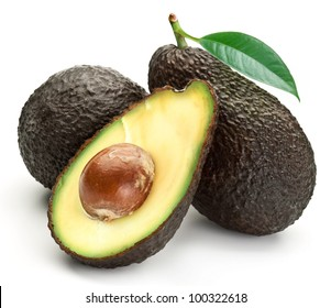 Brown avocado with avocado leaves on a white background. Variety of avocado - Lamb Hass.