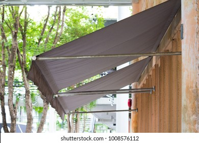 brown awning over restaurant windows.