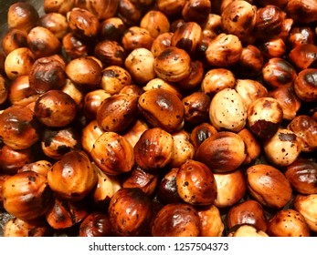 Brown background - strongly roasted nuts.