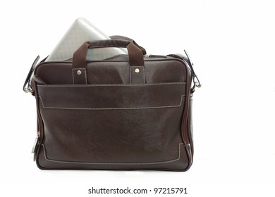 brown bag with computer over white background