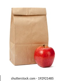 Brown Bag Lunch with a red apple, isolated with a clipping path, on a white background.