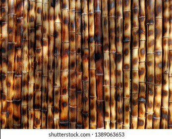 Brown bamboo background wall fence texture, asia traditional pattern. Dark brown color bamboo stick texture background. Bamboo brown tropical texture background as interior or exterior bambu decor