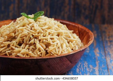 Brown Basmati Rice in a wooden bowl / Cooked Brown basmai rice, selective focus