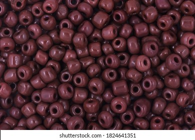 Brown Beads on the white background. Background or texture of beads. Close up, macro,It is used in finishing fashion clothes. make bead necklace or string of beads for woman of fashion.