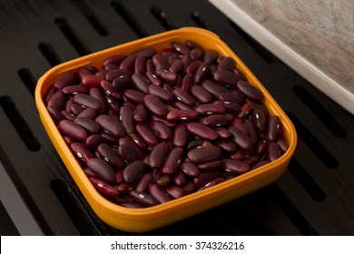 brown bean in a bowl on wooden tray