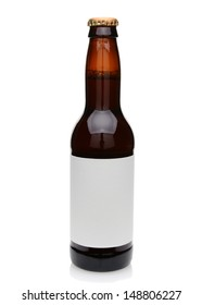 A brown beer bottle with blank label. Isolated on white.
