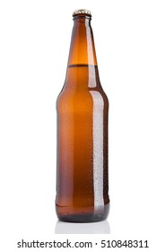 Brown beer bottle cold with frost on white background with reflection