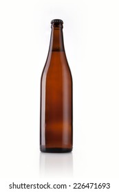 A brown beer bottle on the reflective bottom isolated white.