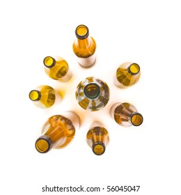 Brown beer bottles seen from above isolated on white background