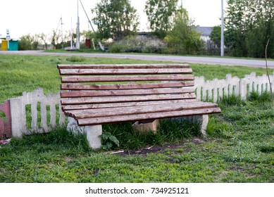 A brown bench at the Russian village