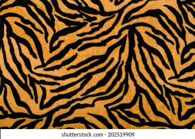 Brown and black tiger pattern. Fur animal print as background.