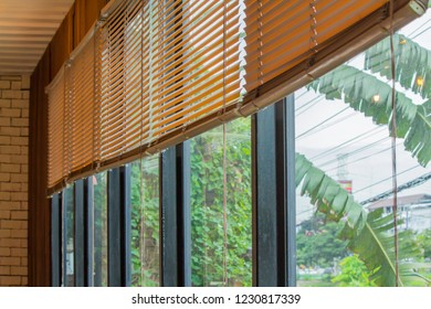 brown blind, jalousie, curtain, Louvers , shade, roller, shutter protected sunlight background and glass room.