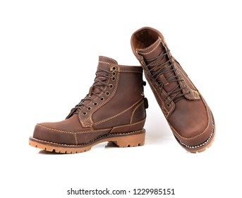 Brown boot with Nubuck leather isolated on a white background.