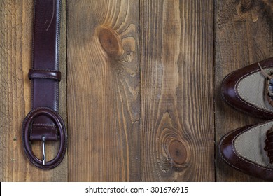 brown boots and a belt on a wooden table