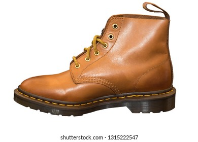 Brown boots with flat soles, protective footwear for motorcycle, isolated.