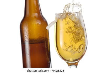 Brown bottle and glass with beer and bubbles
