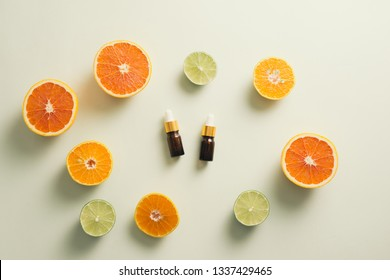 Brown Bottle with lemon, orange, tangerine and vitamin C. on white background.