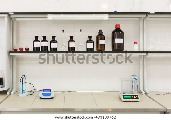 Brown bottles on a shelf in the laboratory. Concept: Research Lab