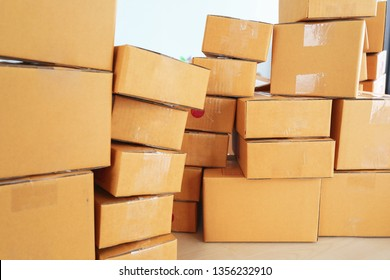 brown box post package many size preparing express delivery for consumer order in home office of freelance work online