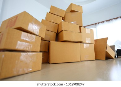 brown box post package many size preparing express delivery for customer order in home office of freelance work online