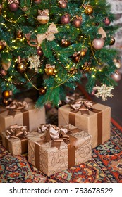 Brown boxes with Christmas gifts on the background of a Christmas tree. Home Decor in Christmas