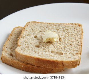 Brown bread with butter on top
