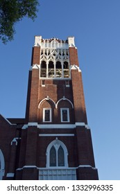 Brown Brick Church Tower with Bells