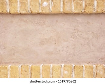 Brown brick frame isolated on the background of the earth wall with copy space.texture of wall.wallpaper for text,memo and photo.