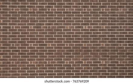 Brown brick textured wall.
