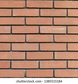 brown brick wall close up seamless background, space for text