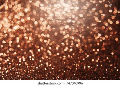 Brown bright abstract bokeh background. Sparkle texture for birthday card, new year, christmas, party and other holidays invitation backdrop.