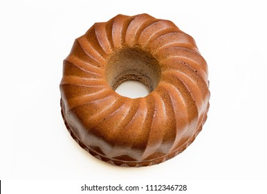 brown Bundt cake isolated on white background