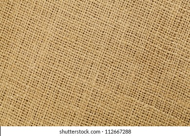 brown burlap fabric background texture with diagonal pattern