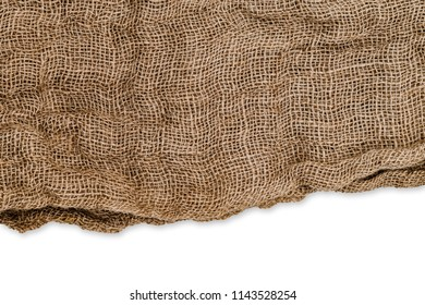 Brown burlap hemp cloth with uneven edge isolated on white